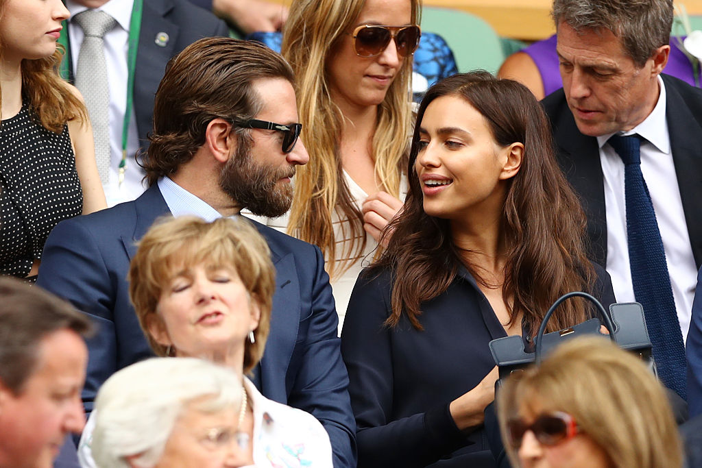 LONDON, ENGLAND - JULY 10:  Bradley Cooper and Irina Shayk look on prior to the Men's Singles Final match between Andy Murray of Great Britain and Milos Raonic of Canada on day thirteen of the Wimbledon Lawn Tennis Championships at the All England Lawn Tennis and Croquet Club on July 10, 2016 in London, England.  (Photo by Julian Finney/Getty Images)